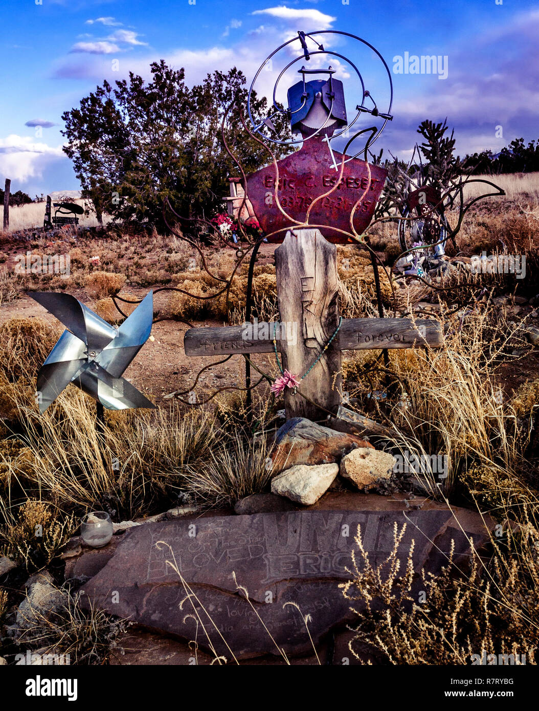 Cemetery at Madrid New Mexico where creative grave markers show the talents of the dead. - Stock Image