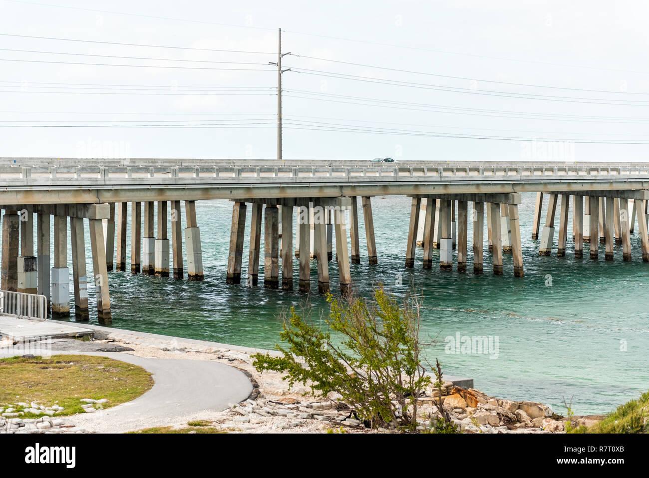 Seven Mile Bridge landscape of Florida Keys water atlantic ocean, beach on Overseas Highway, car on road - Stock Image