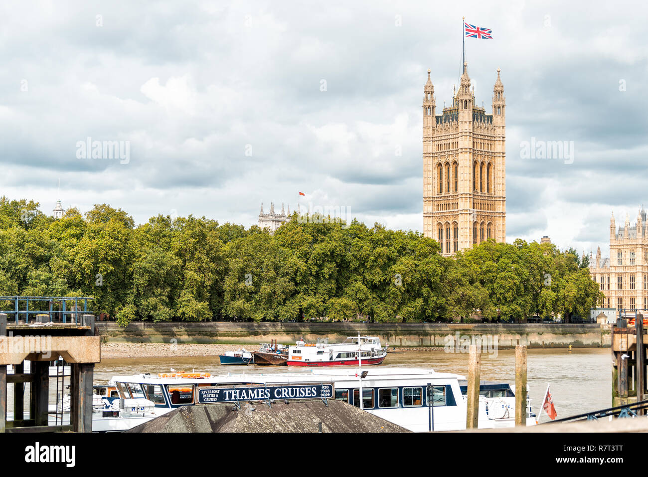 London, UK - September 14, 2018: Cityscape skyline of city with Thames River, Westminster during cloudy overcast autumn, cruises boat on Albert Embank - Stock Image