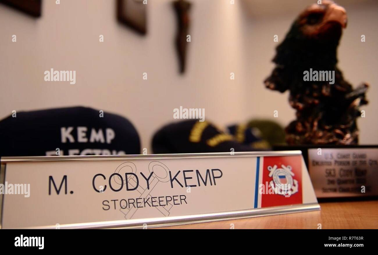 Coast Guard Petty Officer 2nd Class Michael Cody Kemp's name plaque sits on display in his downtown Seattle office, Mar. 21, 2017. Kemp, a storekeeper stationed with the 13th District, has been in the Coast Guard for six years and enjoys hiking during his free time. U.S. Coast Guard - Stock Image