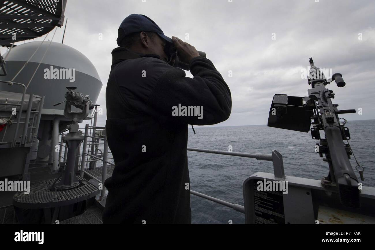 Seaman Luis Figuereo scans for contacts while on watch aboard USS Leyte Gulf (CG 55). Leyte Gulf is conducting naval operations in the U.S. 6th Fleet area of operations in support of U.S. national security interests in Europe. Stock Photo