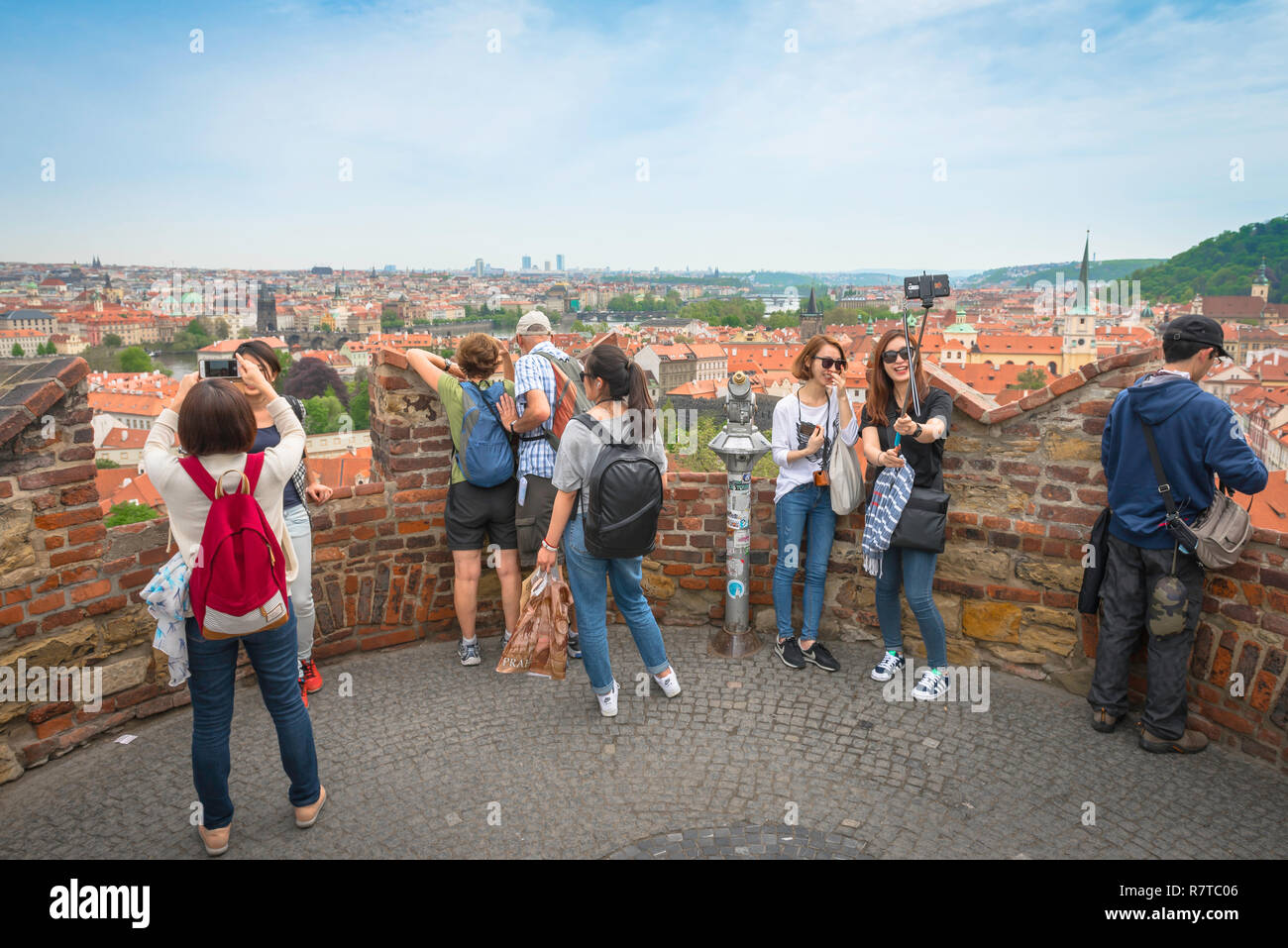 Tourists selfie, tourists take photos from a terrace on the Prague Castle Garden wall in the Hrad district, Prague, Czech Republic. - Stock Image