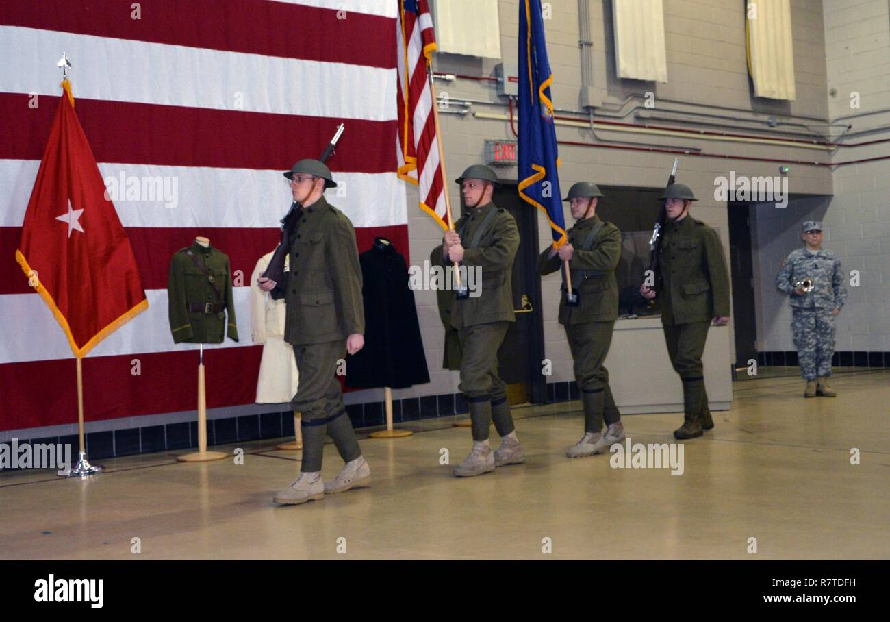 LATHAM, N.Y. --  Sgt. 1st Class Brian Swanhall stands by to play Taps as the World War I Doughboy Color Guard of the New York National Guard's 42nd Infantry Division march into the World War I centennial ceremony at the New York State Division of Military and Naval Affairs headquarters here on April 6. In addition to highlighting the 100th anniversary of the United States' entry into World War I, the ceremony also marked the beginning of New York State's World War I Centennial observances. The color guard troops are (from left to right): Spc. Kyle Williams of Amsterdam, N.Y.; Staff Sgt. Garbar Stock Photo