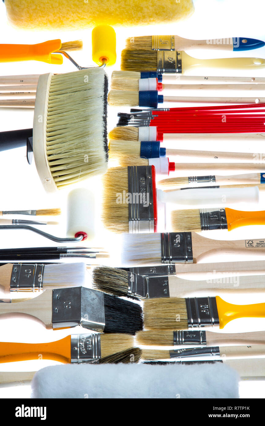 Different types of brushes and paint rollers - Stock Image