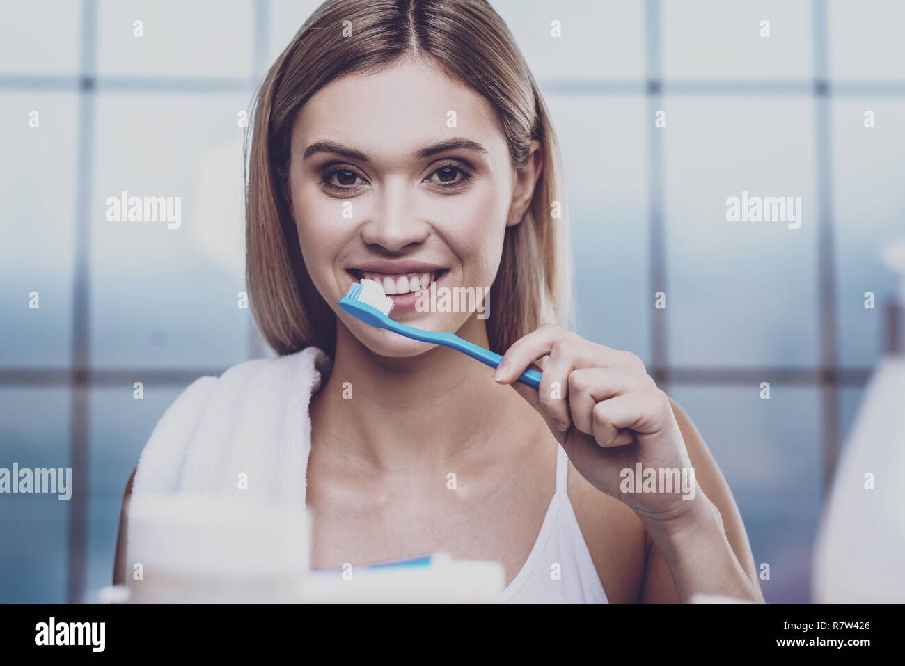 Pleasant young woman cleaning teeth Stock Photo