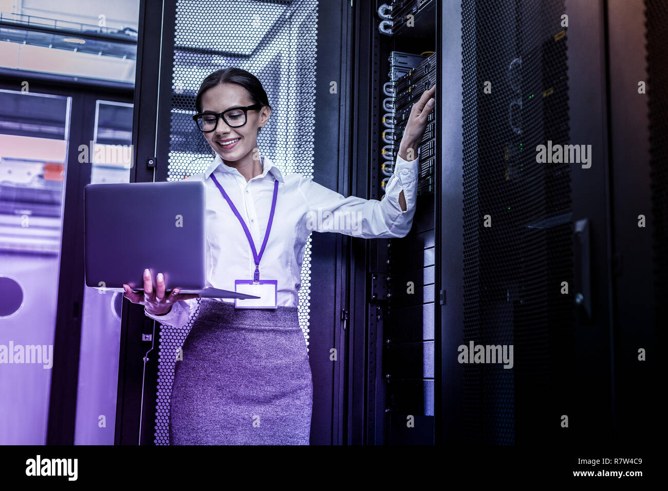 Happy nice young woman pressing a button - Stock Image