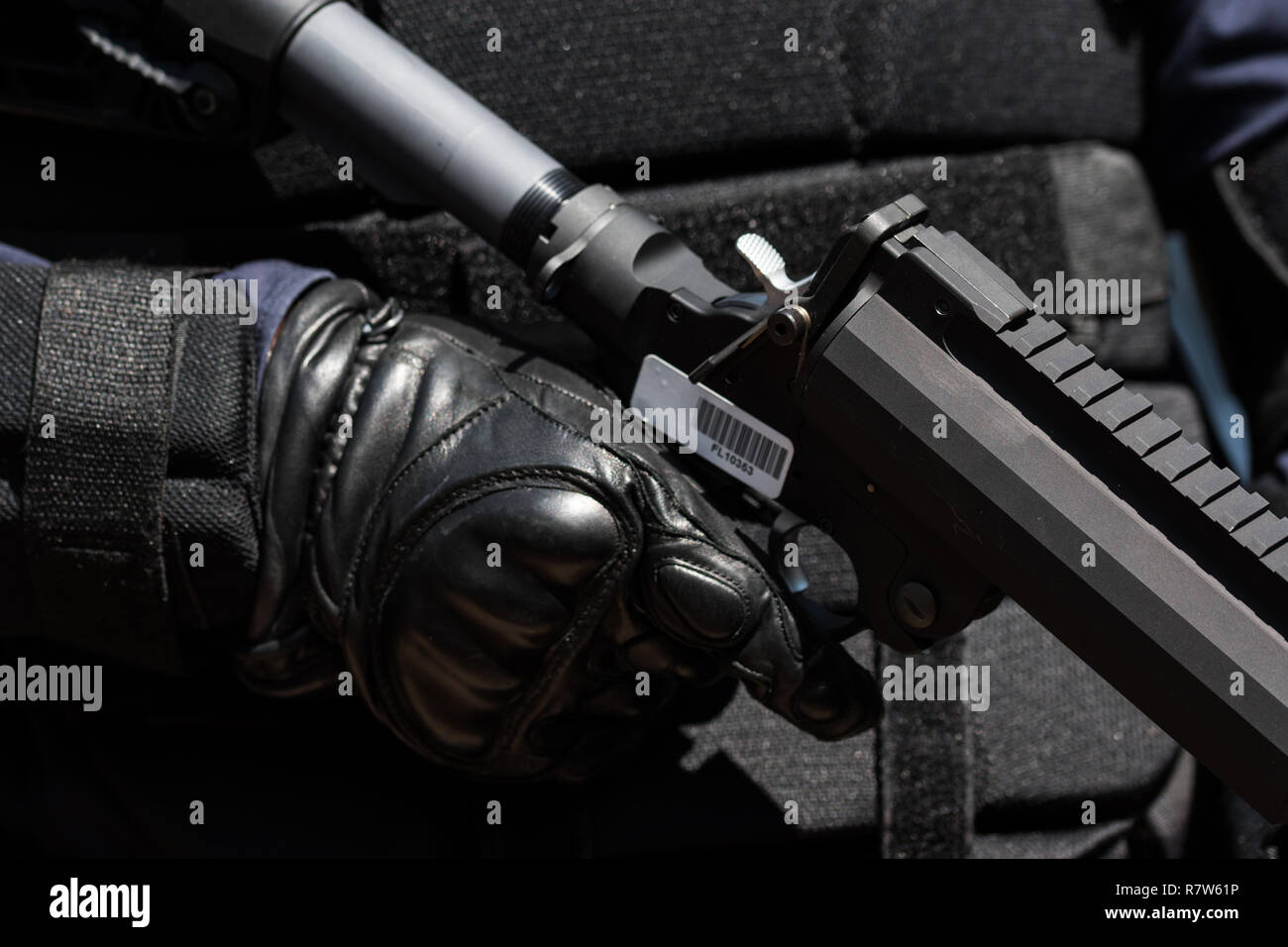 Riot police with tear gas , face shields and body armor gear up to protect KKK from protesters - Stock Image