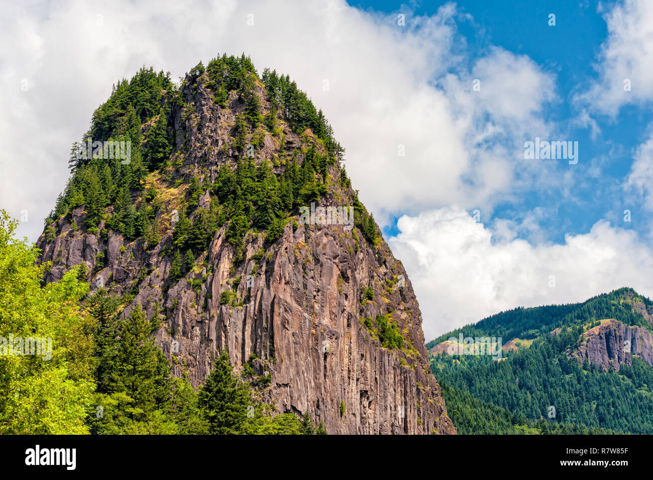 Beacon Rock on the Washington side of the Columbia River Gorge.  A trail winds it's way up to the basalt rock top. - Stock Image
