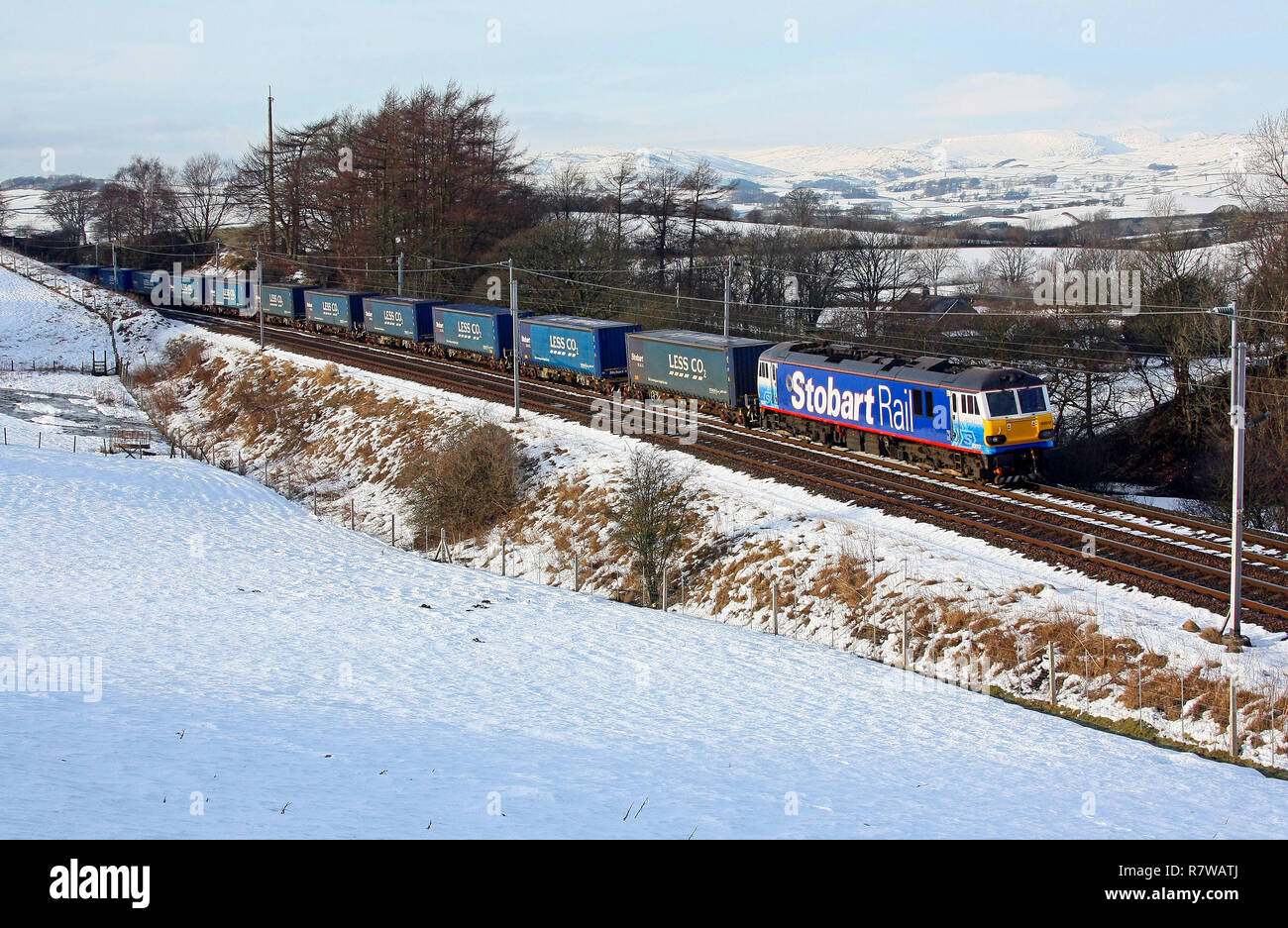 92017 in Stobart livery runs the first Tesco Express on 4.1.10 through snowy Beckhouses. Stock Photo