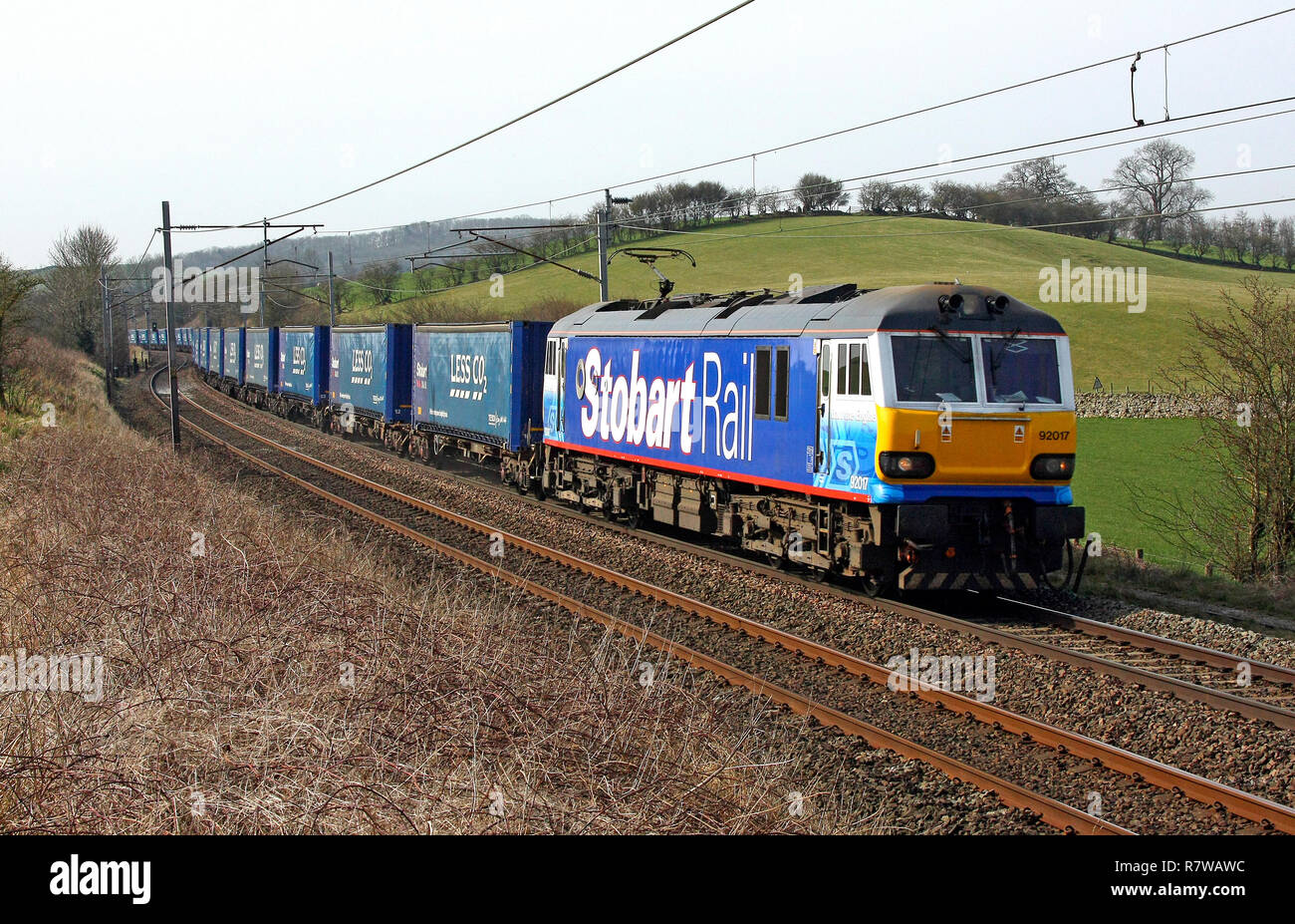 92017 heads past Well Heads in the Stobart Rail livery named as Bart the Engine. - Stock Image