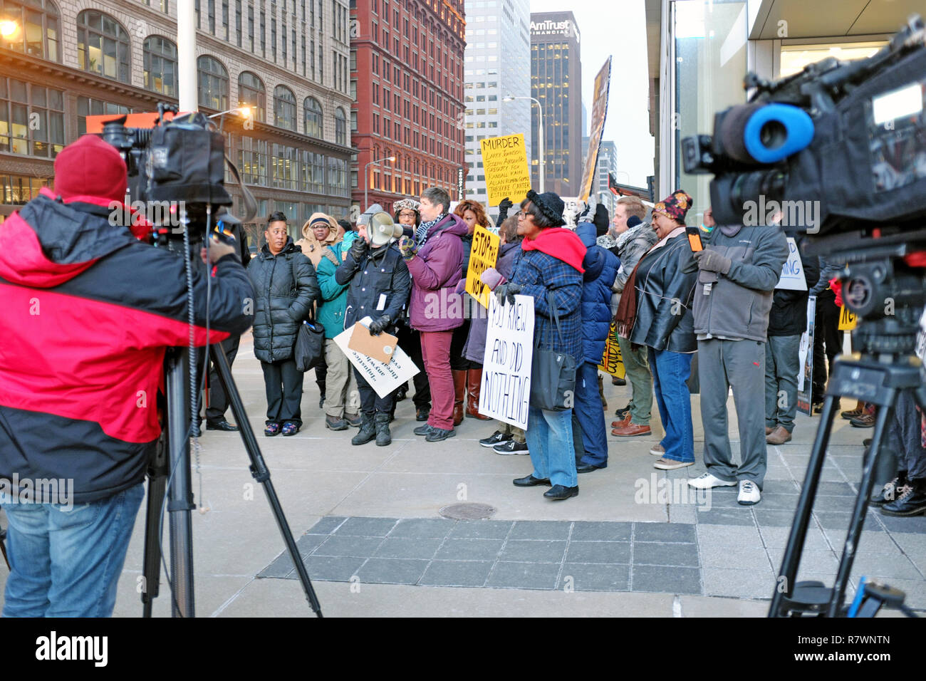 Cleveland, Ohio, USA, 11th Dec, 2018.  Protesters converge on East 9th Street in downtown Cleveland, Ohio outside the Cuyahoga County Administration Building to protest the 'inhumane' conditions of the jail system as well as the death of 7 inmates in the past 6 months.  The protesters include those with loved ones who died in the care of Cuyahoga County Jails.  One sign includes the names of all of those who have died in their custody which triggered a federal review of the jail resulting in a scathing report by the U.S. Marshals. Credit: Mark Kanning/Alamy Live News - Stock Image