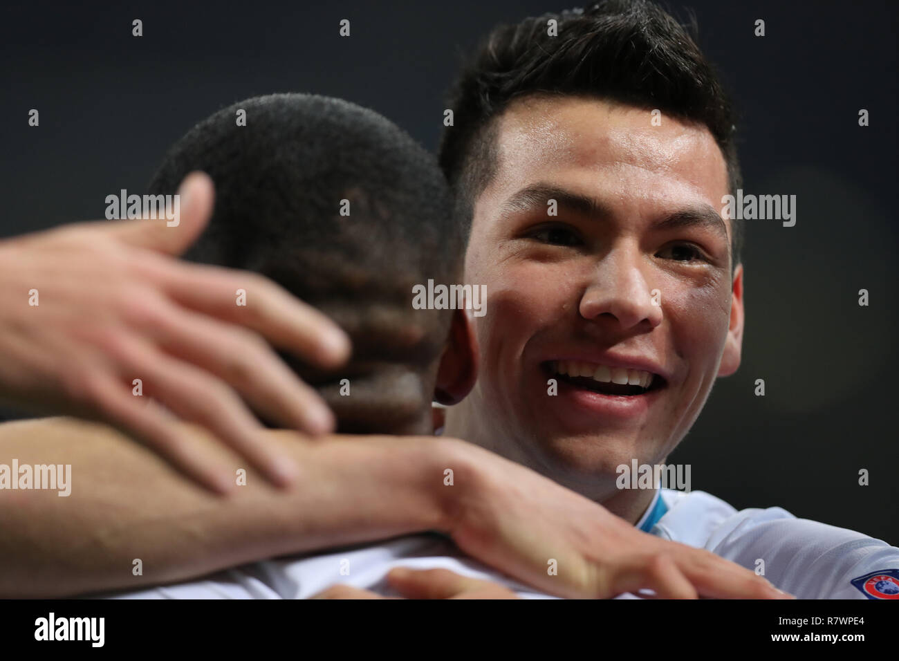 Milan, Italy. 11th Dec, 2018. PSV Eindhoven's Hirving Lozano (R) celebrates a goal during a Group B match of the UEFA Champions League between FC Inter and PSV Eindhoven in Milan, Italy, Dec. 11, 2018. The match ended with 1-1. Credit: Cheng Tingting/Xinhua/Alamy Live News Stock Photo