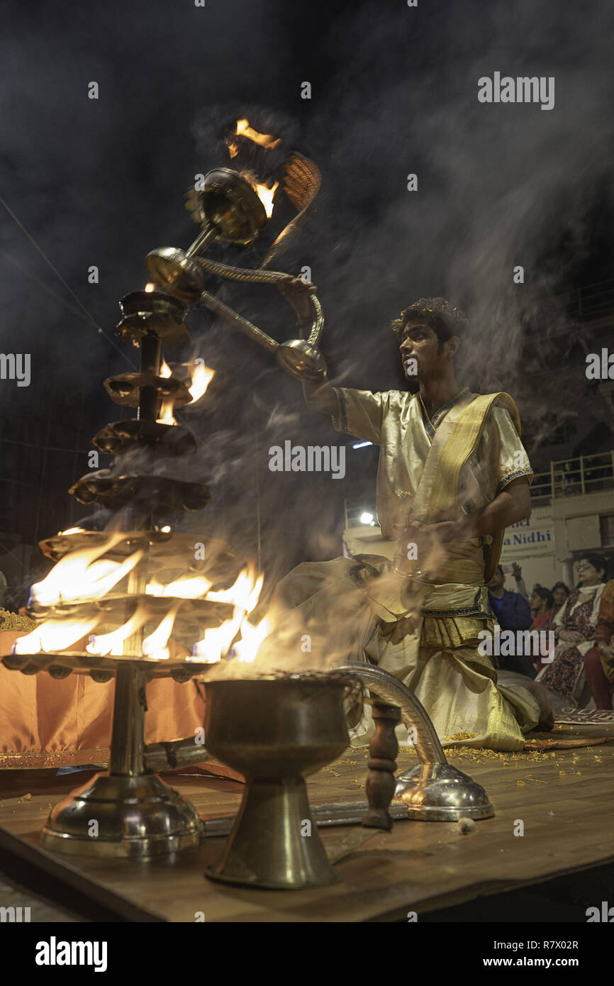 July 24, 2018 - Varanasi, Uttar Pradesh, India - A Hindu priest seen performing at the Aarit ceremony on the banks of the Ganges river..Varanasi is a city in the northern Indian state of Uttar Pradesh dating to the 11th century B.C. Regarded as the spiritual capital of India, the city draws Hindu pilgrims who bathe in the Ganges River's sacred waters and perform funeral rites. The river is dedicated to the Hindu god Shiva. (Credit Image: © Enzo Tomasiello/SOPA Images via ZUMA Wire) - Stock Image