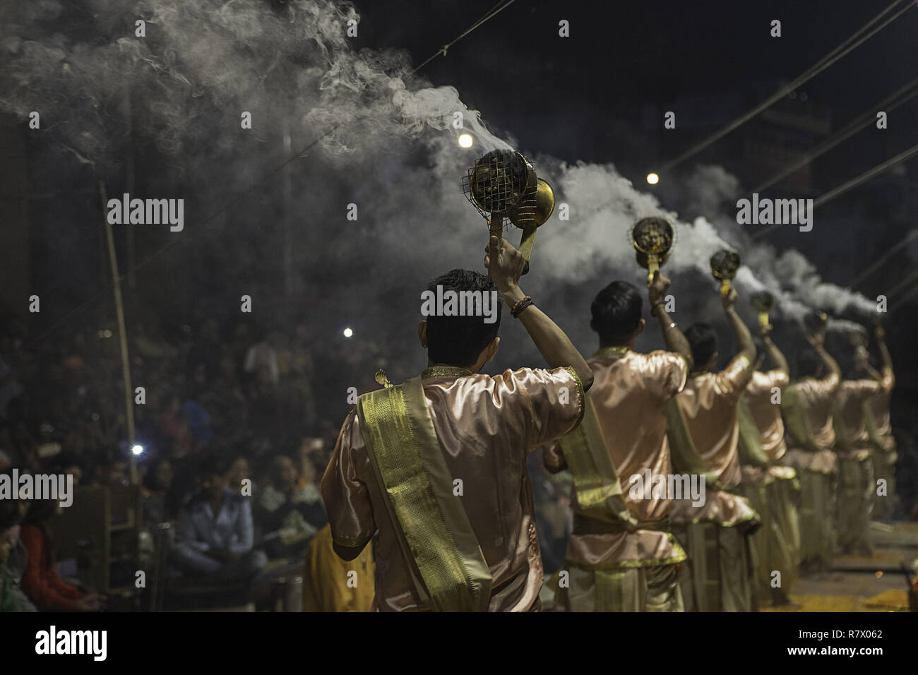 July 25, 2018 - Varanasi, Uttar Pradesh, India - Hindu priests are seen performing at the Aarit ceremony on the banks of the Ganges river..Varanasi is a city in the northern Indian state of Uttar Pradesh dating to the 11th century B.C. Regarded as the spiritual capital of India, the city draws Hindu pilgrims who bathe in the Ganges River's sacred waters and perform funeral rites. The river is dedicated to the Hindu god Shiva. (Credit Image: © Enzo Tomasiello/SOPA Images via ZUMA Wire) - Stock Image
