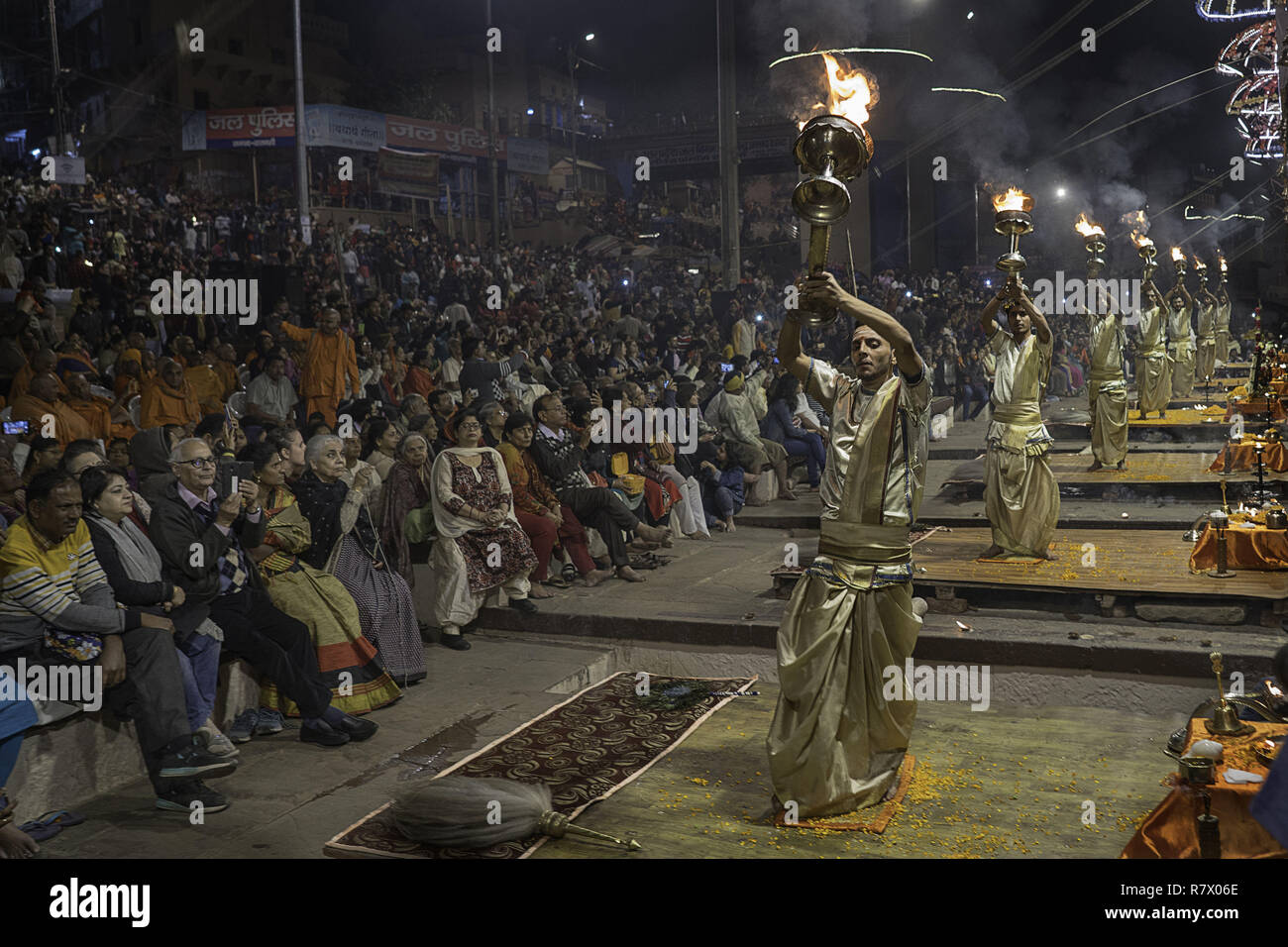 July 24, 2018 - Varanasi, Uttar Pradesh, India - Hindu priests seen performing at the Aarit ceremony on the banks of the Ganges river..Varanasi is a city in the northern Indian state of Uttar Pradesh dating to the 11th century B.C. Regarded as the spiritual capital of India, the city draws Hindu pilgrims who bathe in the Ganges River's sacred waters and perform funeral rites. The river is dedicated to the Hindu god Shiva. (Credit Image: © Enzo Tomasiello/SOPA Images via ZUMA Wire) - Stock Image