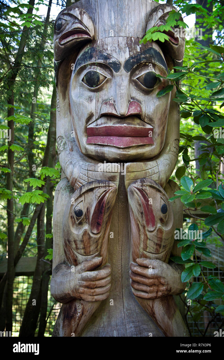 Totem poles at Capilano suspension bridge park, Vancouver BC - Stock Image