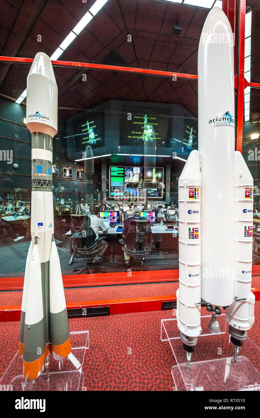 France, French Guiana, Kourou, Guiana Space Center (CSG), Jupiter Command Hall during Soyuz launch campaign, Soyuz rocket reproduction (left) and Ariane V rocket (right) in the foreground - Stock Image