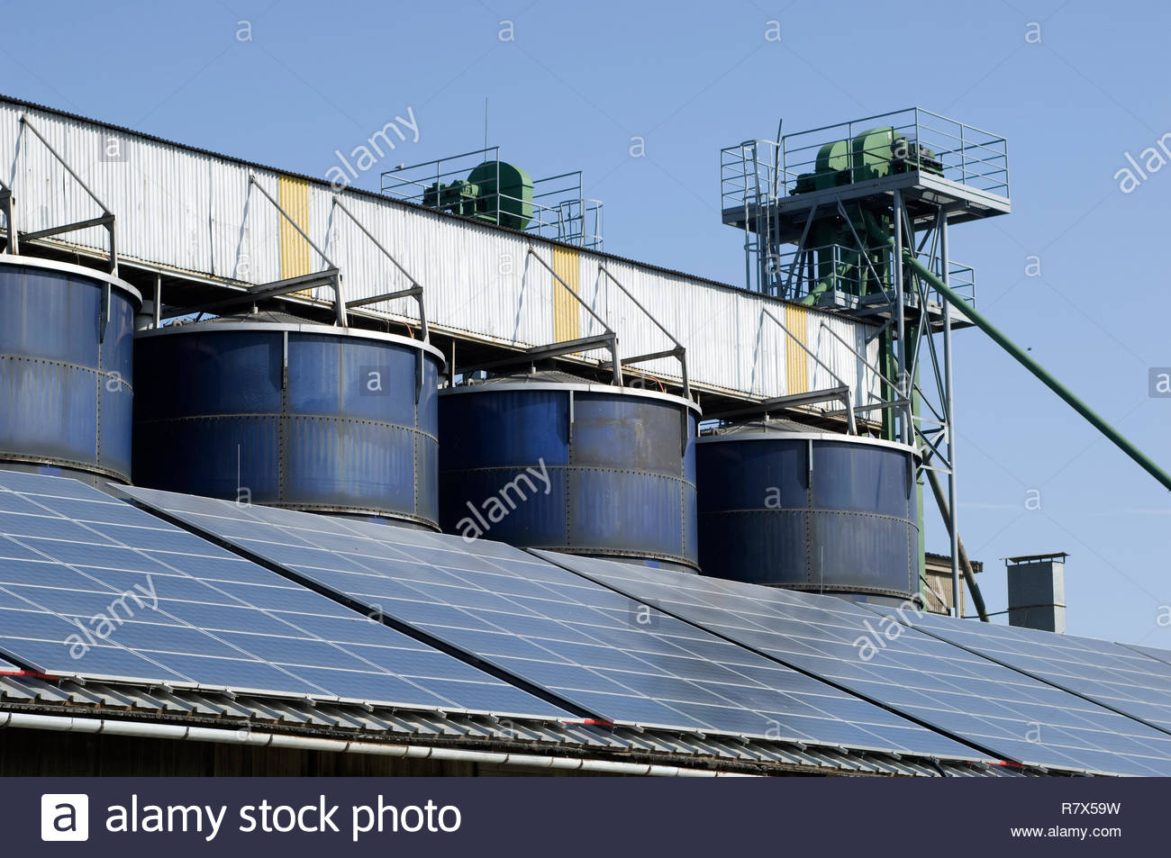 Silage towers with sun panels on the roof Stock Photo