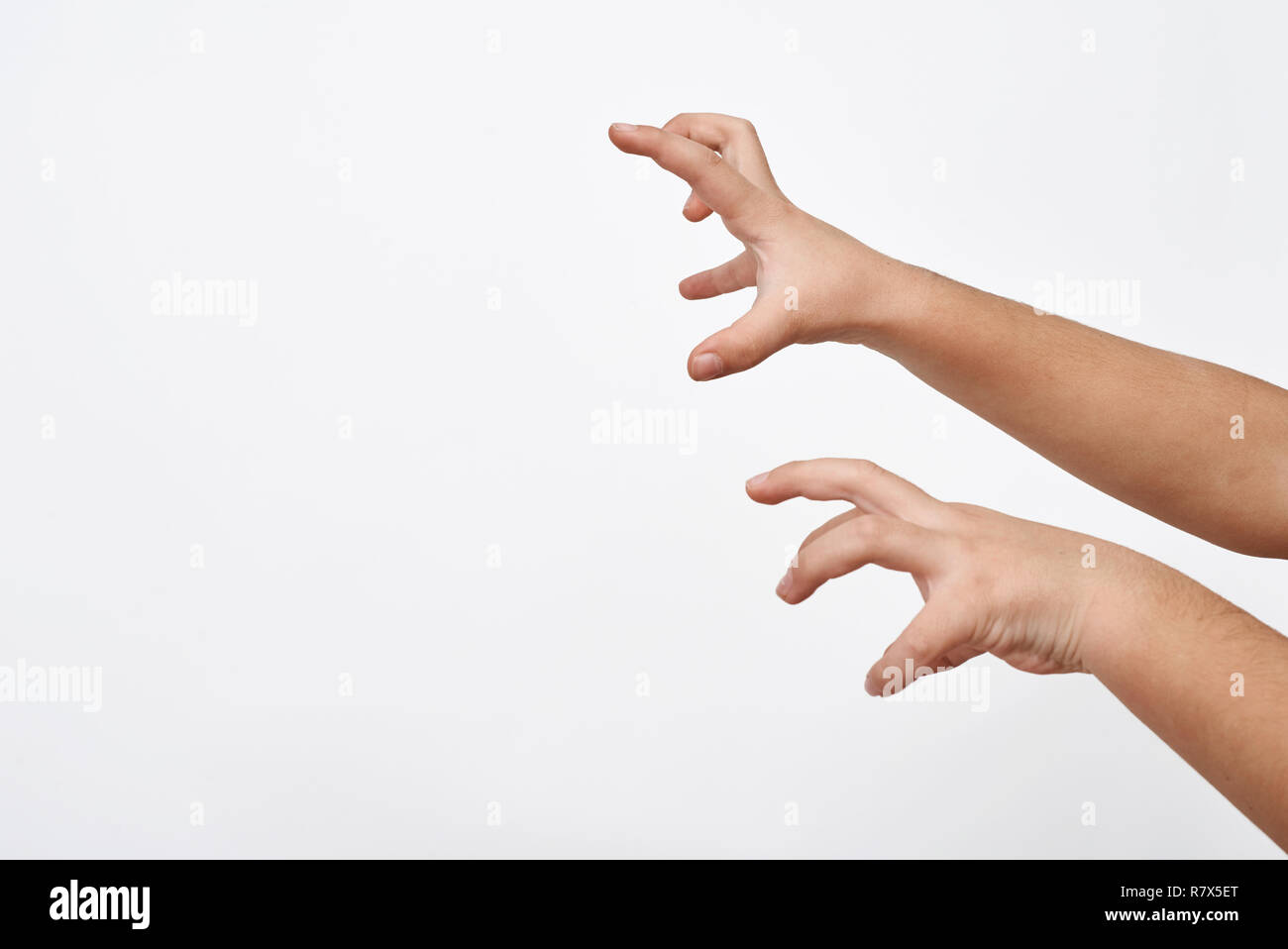 Kid hands trying to scare .Childish intimidation. - Stock Image