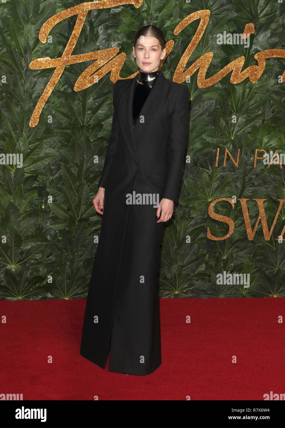 Rosamund Pike seen on the red carpet during the Fashion Awards 2018 at the Royal Albert Hall, Kensington in London. - Stock Image