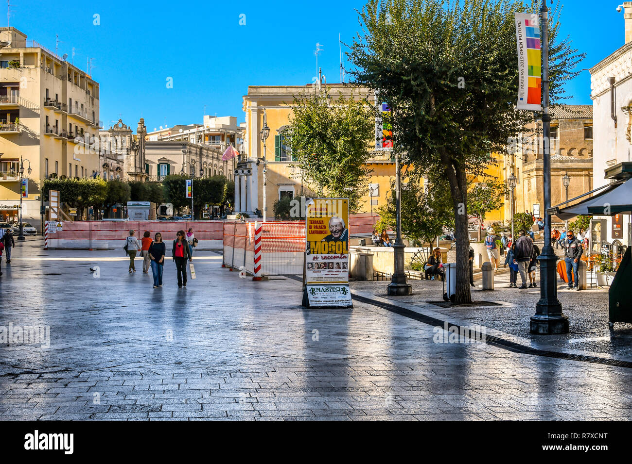 Matera, Italy - September 24 2018: Local Italians enjoy a sunny day in early autumn in the Matera Town Square, Piazza Vittorio Veneto. Stock Photo