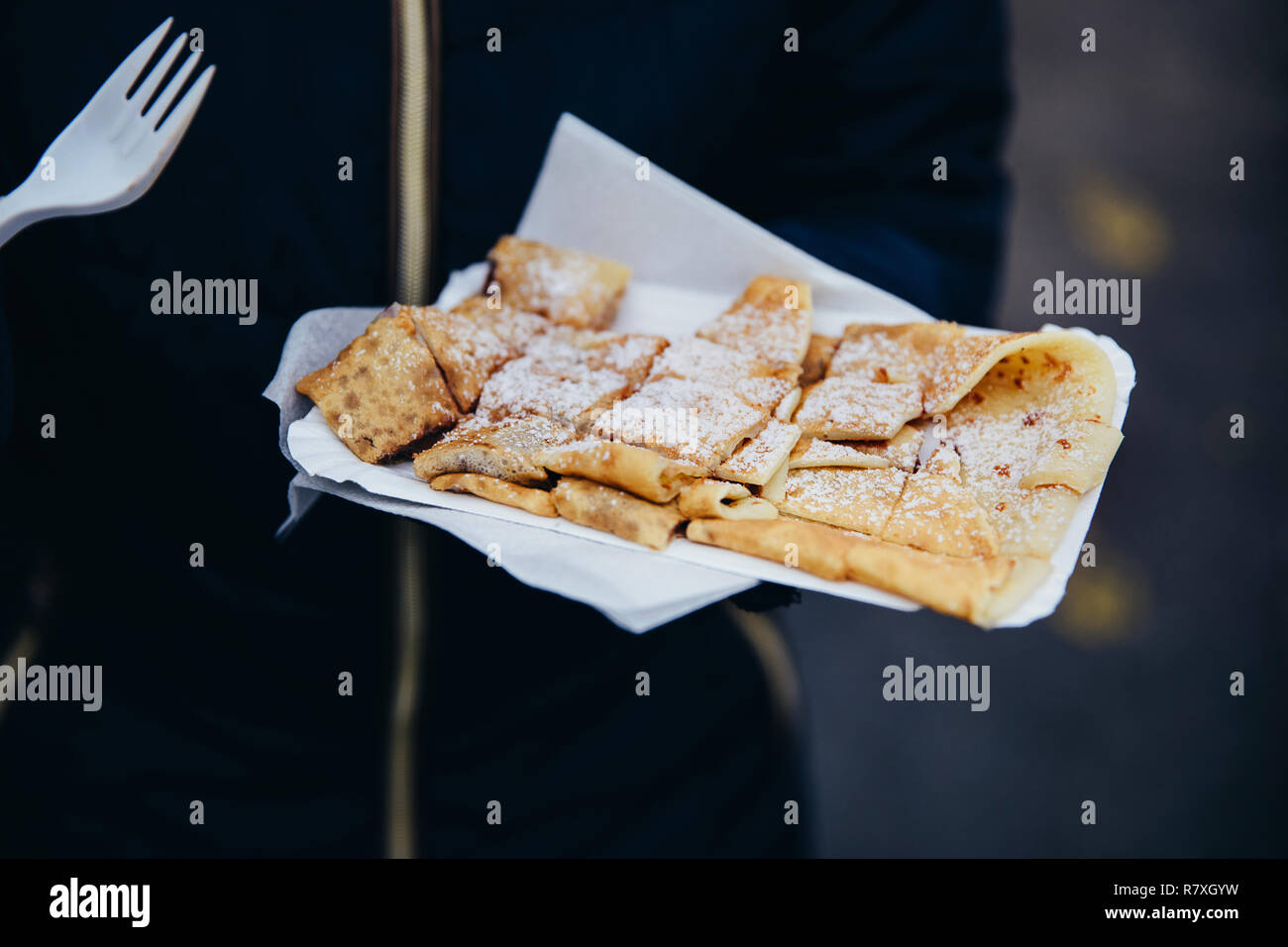 Close-up of freshly prepared crepes which are thin pancakes with chocolate spread filling outside at Christmas market. Popular warm street food in Swi - Stock Image