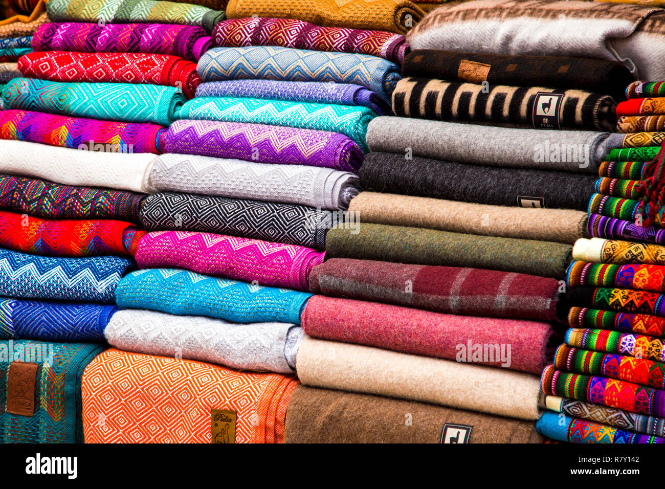 Alpaca wool scarves at the market in Pisac, Sacred Valley, Peru - Stock Image