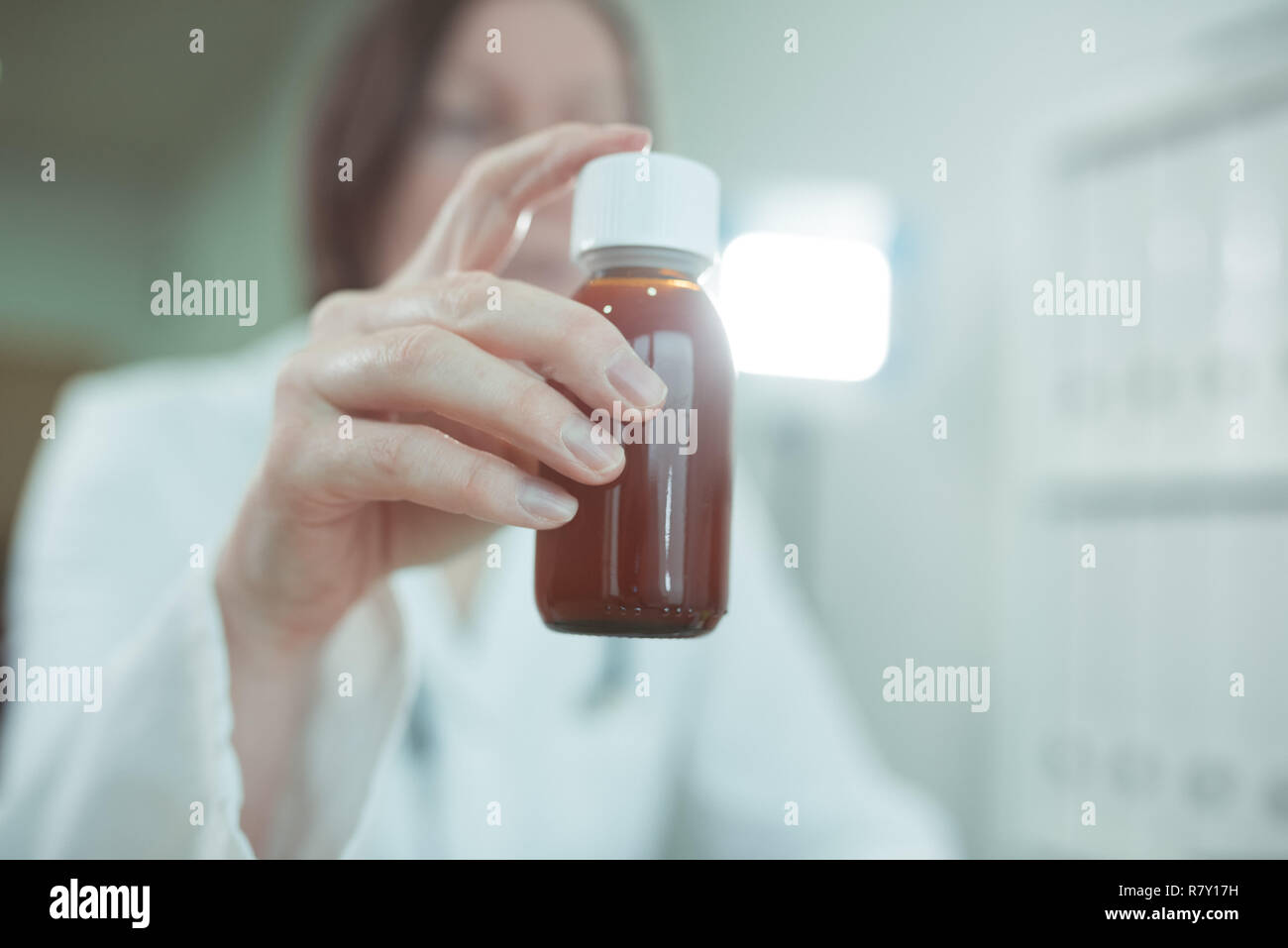 Pediatrician recommends paracetamol syrup for medical treatment of baby patients in pediatrics medical office, selective focus - Stock Image