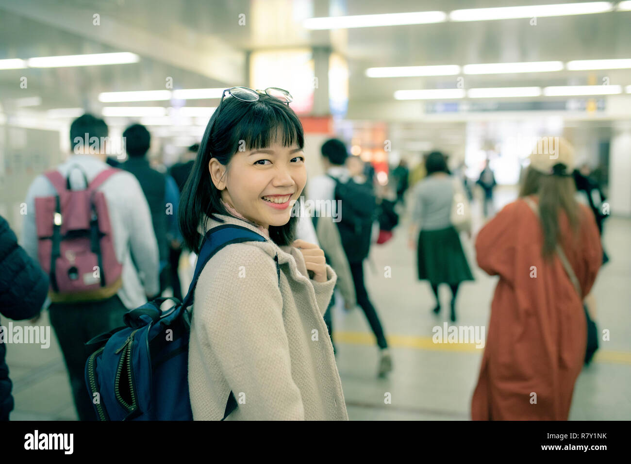 asian younger woman traveling in underground trains station of osaka japan - Stock Image