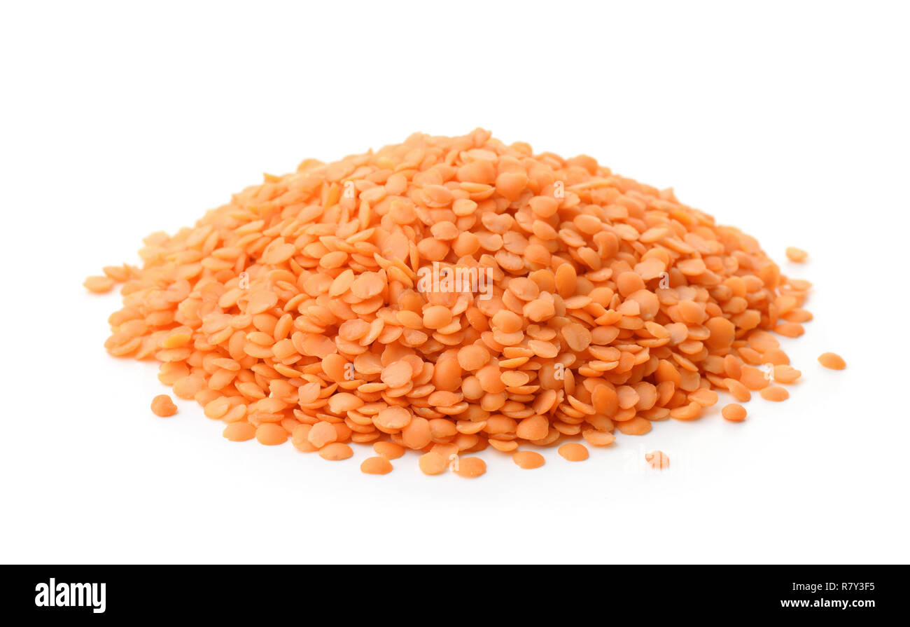 Pile of split red lentil seeds isolated on white Stock Photo