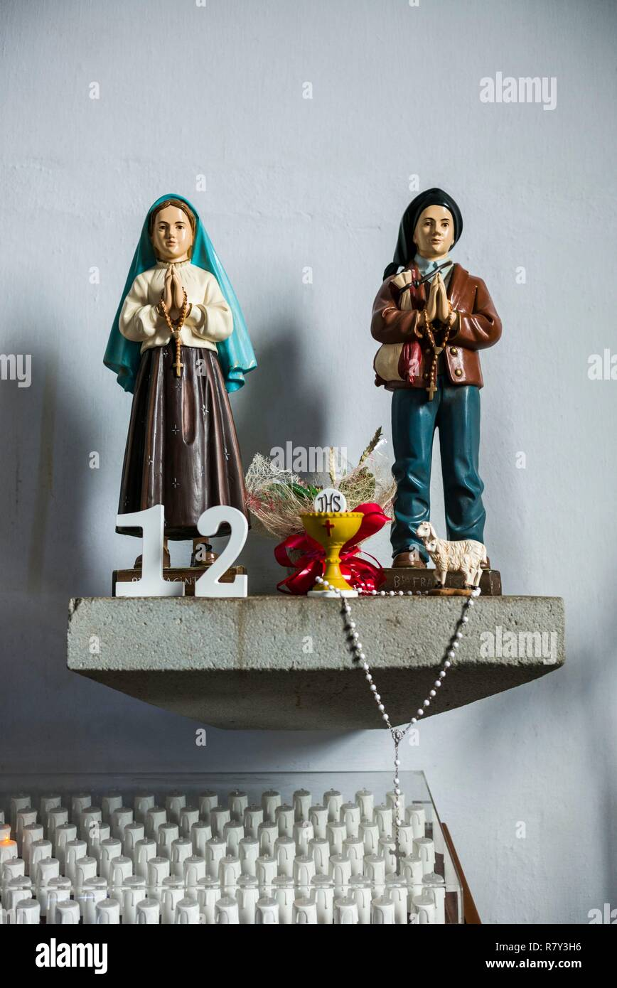 Portugal, Azores, Terceira Island, Sao Sebastiao, 15th century town church, statues of children in traditional clothes - Stock Image