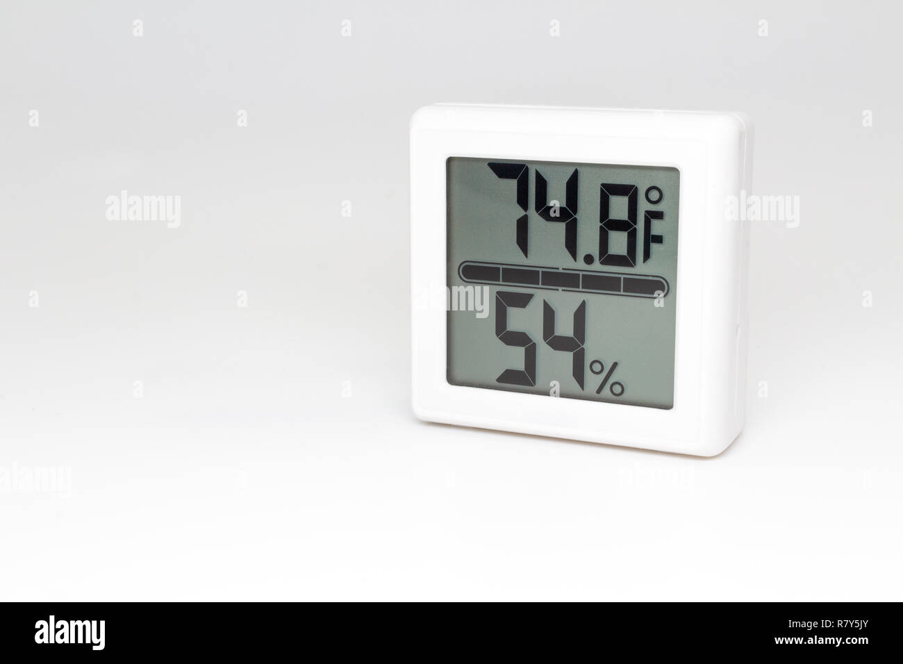 Digital device measuring temperature and humidity. Thermometer and hygrometer. Fahrenheit and percent. - Stock Image