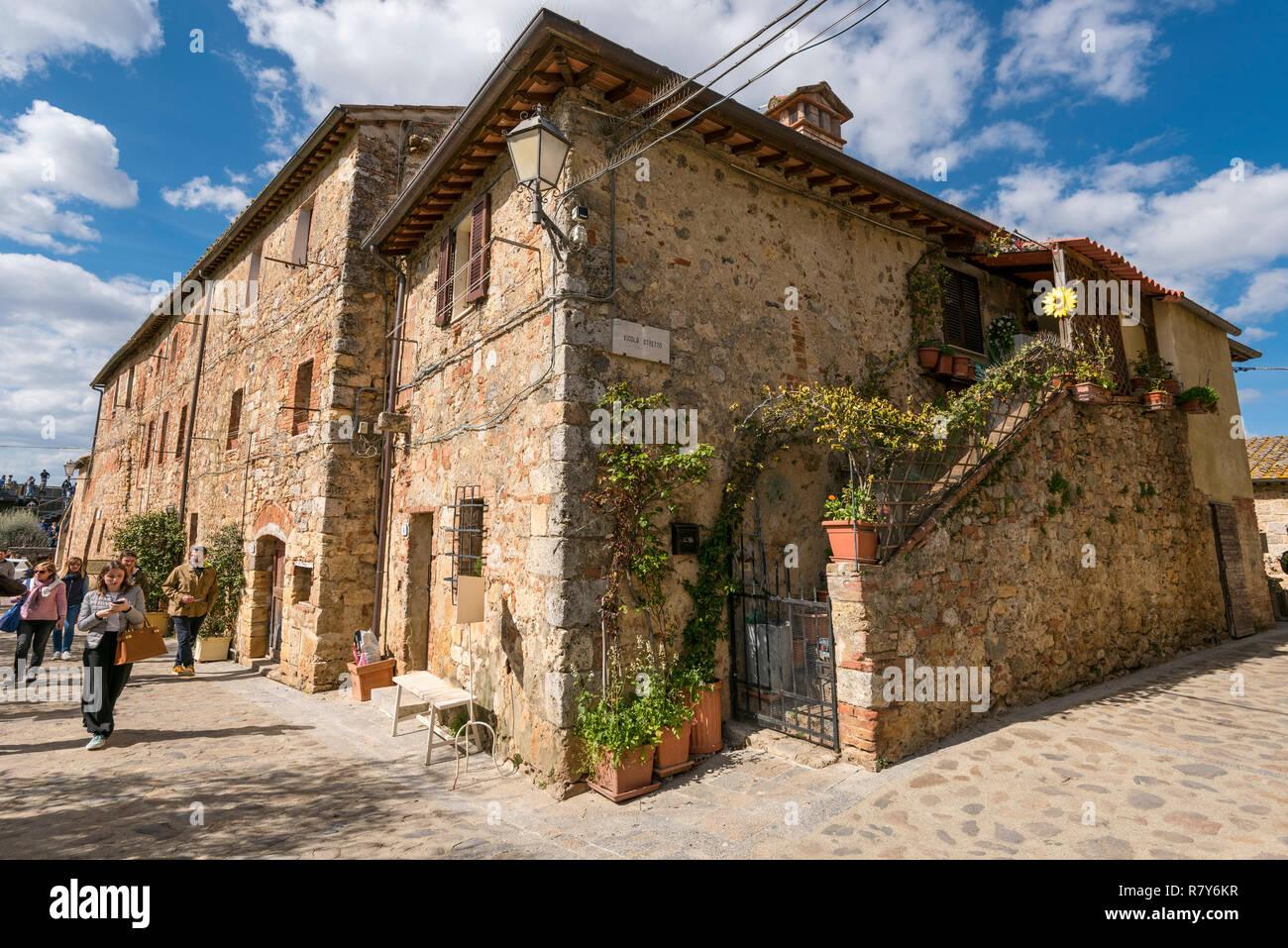 Horizontal streetview inside the walls of Monteriggioni, Italy. - Stock Image
