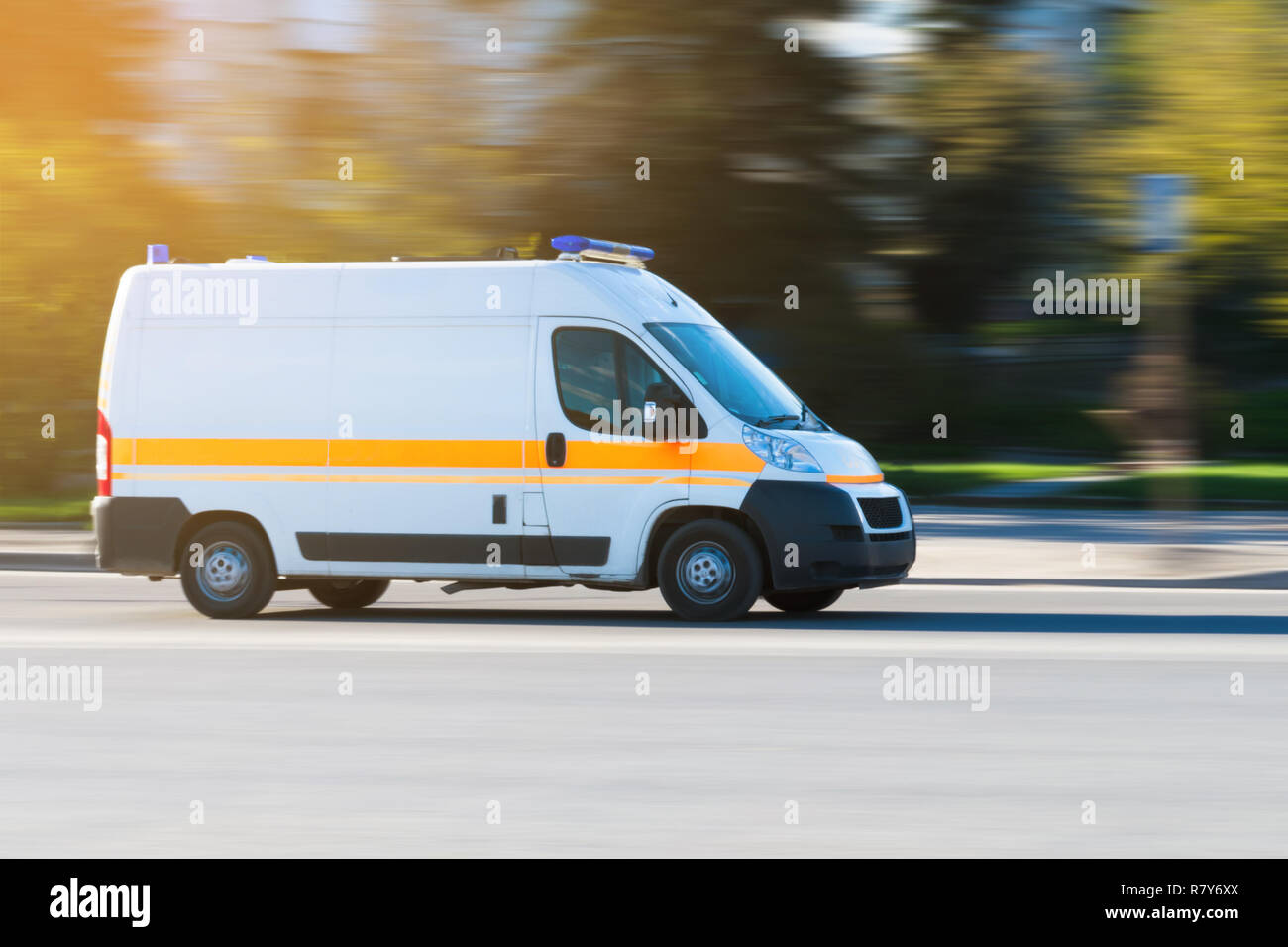 Ambulance in the city on a blurred background. ambulance on emergency call in motion blur. - Stock Image