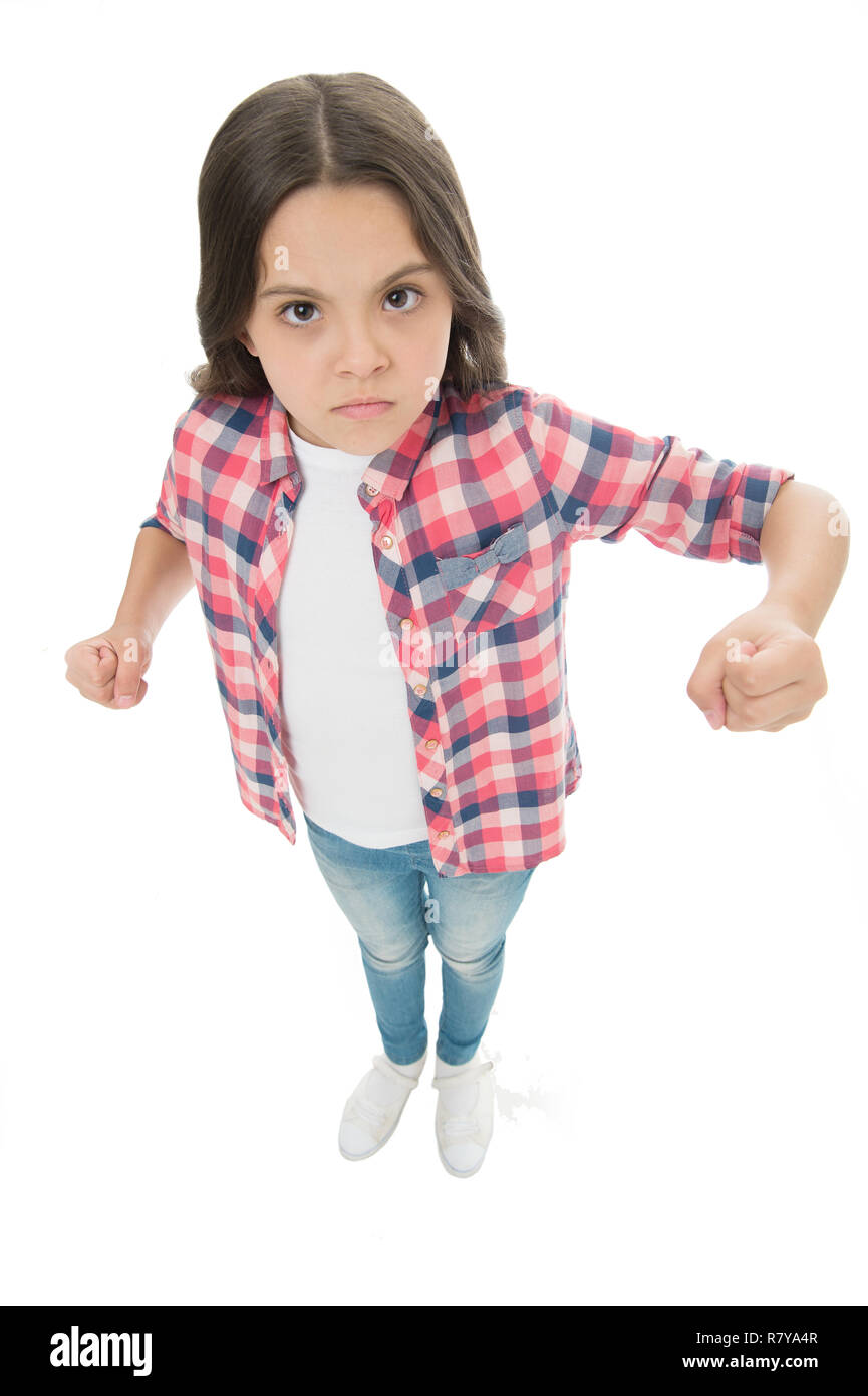 Stop bullying movement. Girl kid threatening with fist. Strong personality temper. Threaten with physical attack. Kids aggression concept. Aggressive girl threatening to beat. Threatening violence. - Stock Image