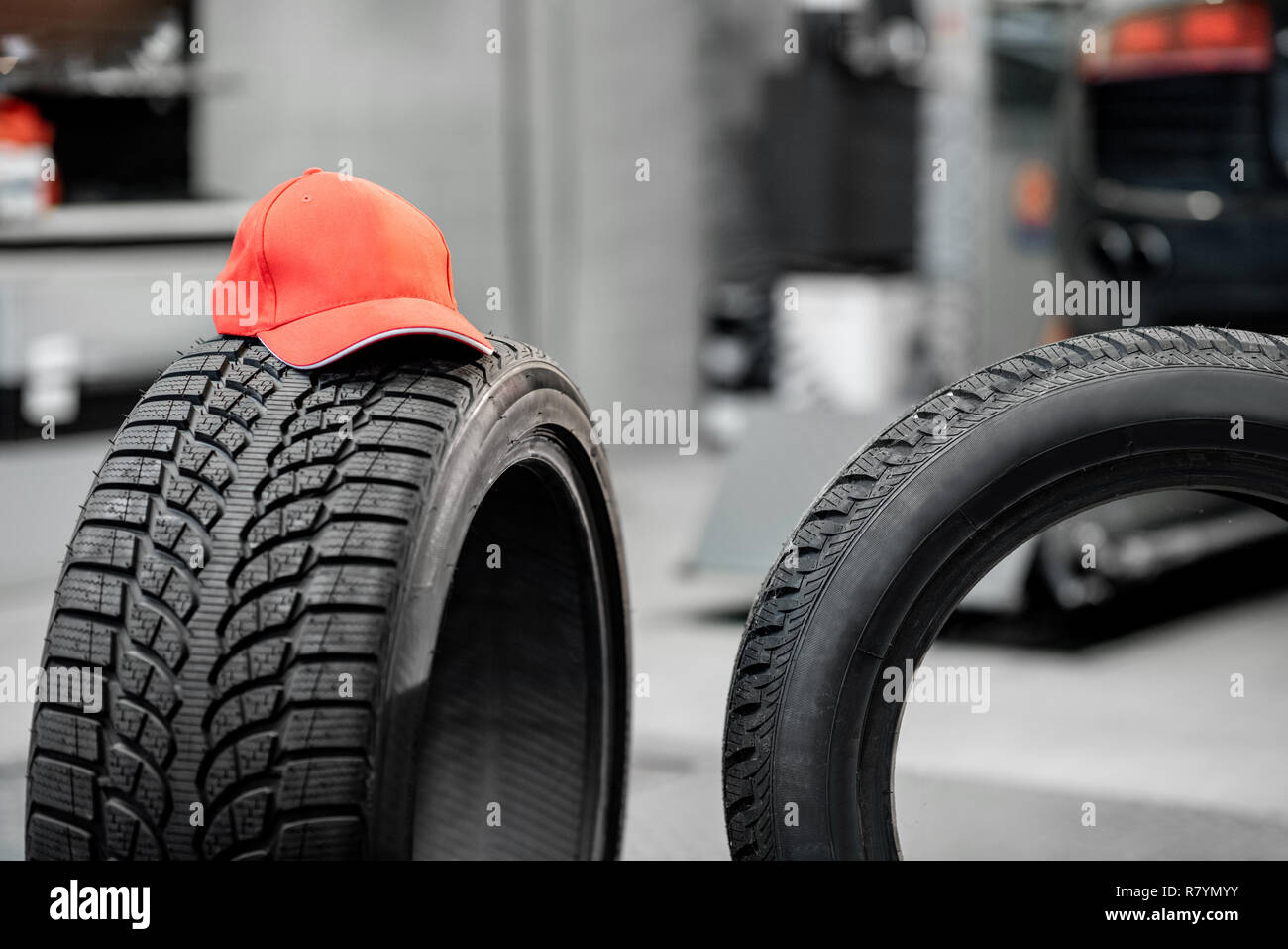 Red Cap On The Tire At The Wheel Mounting Service Stock Photo