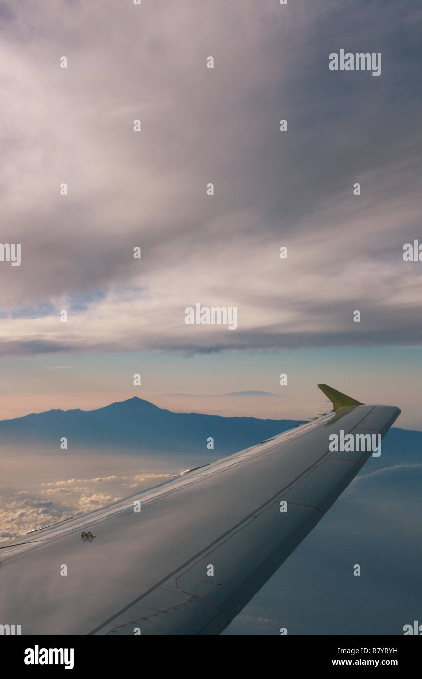 View from the air of the volcano Teide on the island of Tenerife seeing the profile of the island of La Palma in the background, all framed by an airp Stock Photo