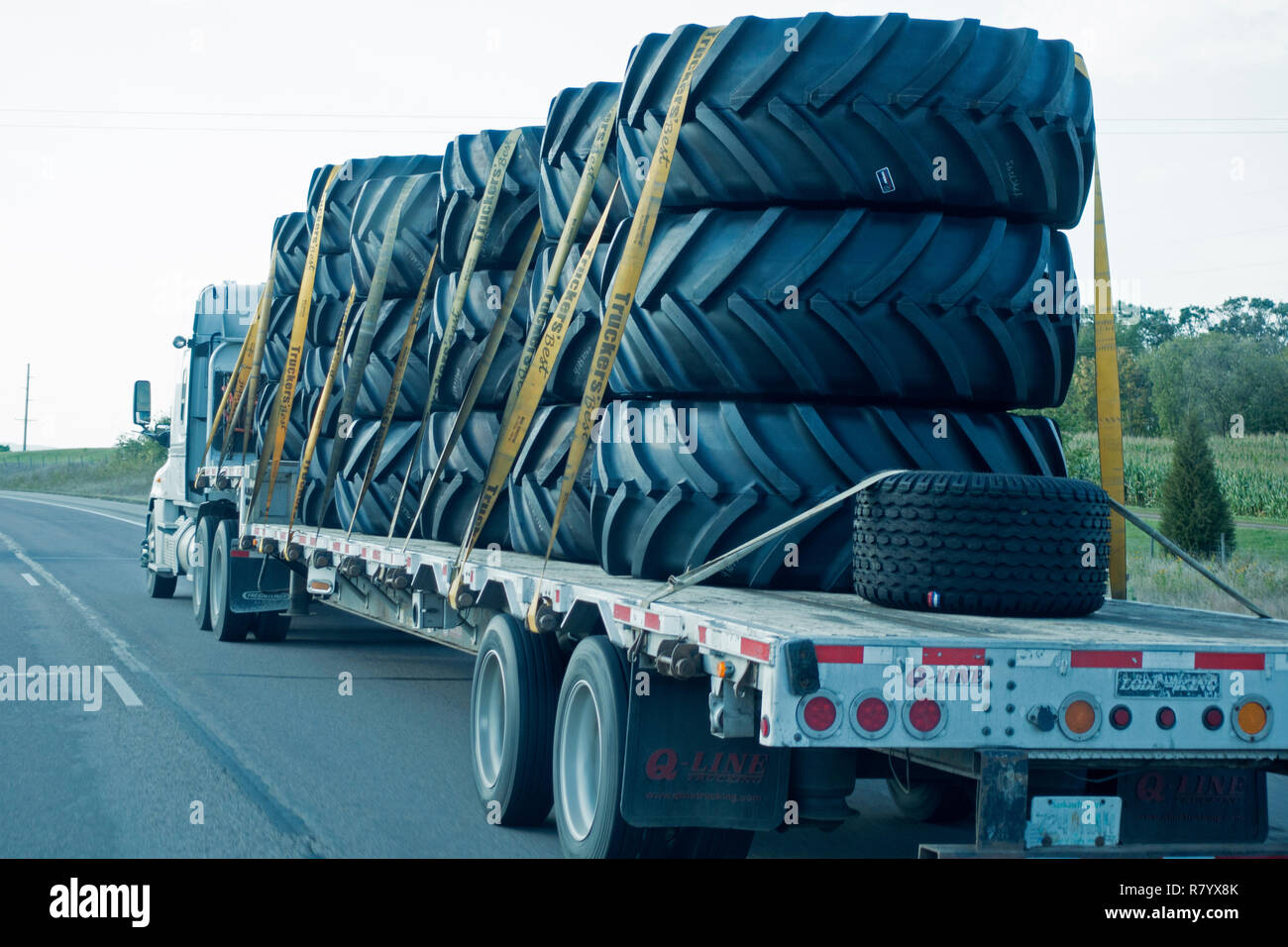 Truck hauling tires for large machines on Freeway 94 Minnesota MN USA - Stock Image