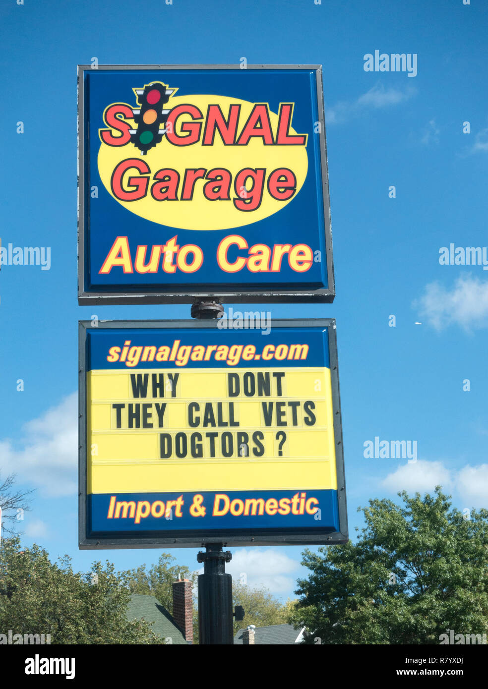 Signal Garage has a clever saying on the sign advertising the garage: 'Why don't they call vets dogtors'. St Paul Minnesota MN USA - Stock Image