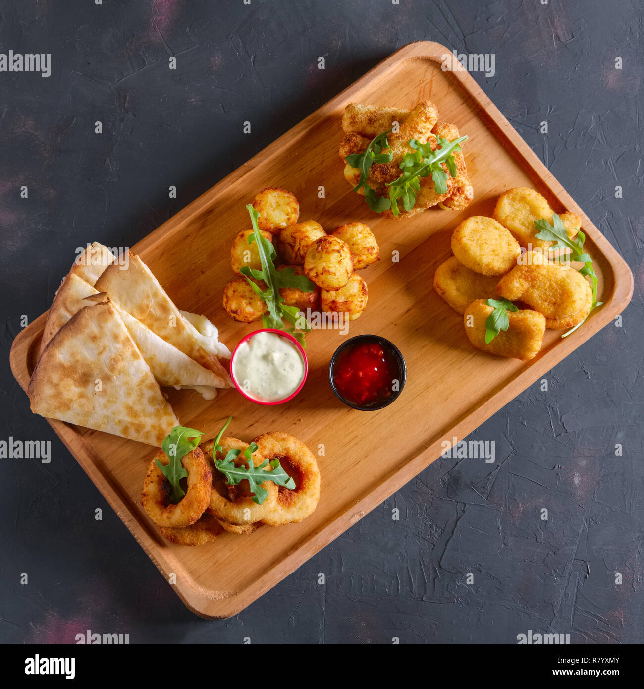 Wooden plate with snack for beer Stock Photo
