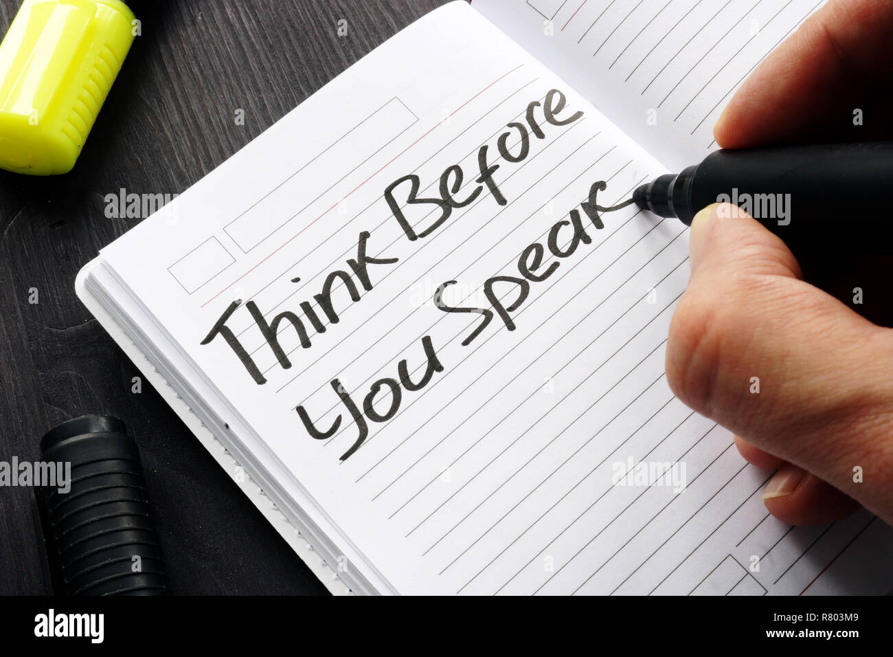 Think Before You Speak handwritten on a note. - Stock Image