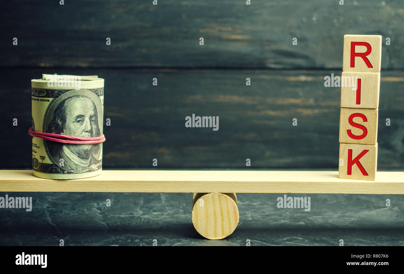 Dollars and the inscription risk are on the scales. The concept of financial and economic risk. Unreliable investment. Unpaid loan. Financial risk man Stock Photo