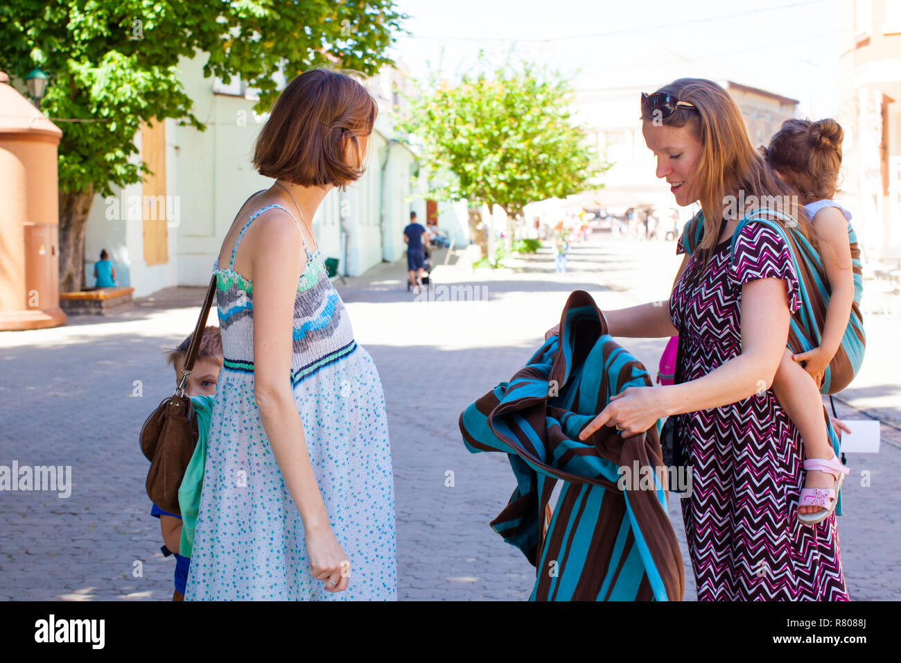 Pregnant Lady Learning How To Use Baby Wrap Stock Photo 228658546