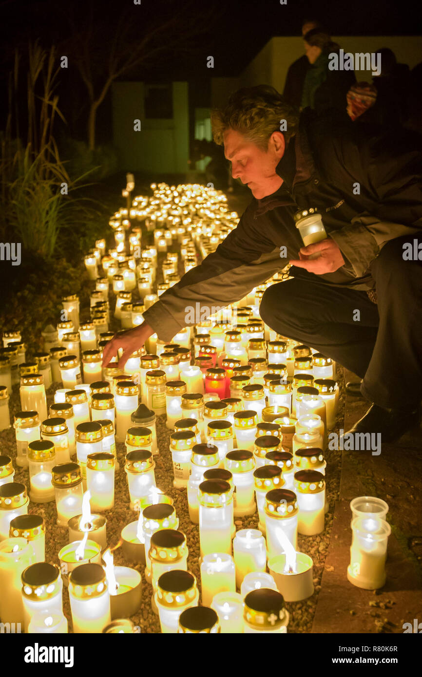 People light on all Saints day at the cemetery, Uppsala, Sweden. - Stock Image