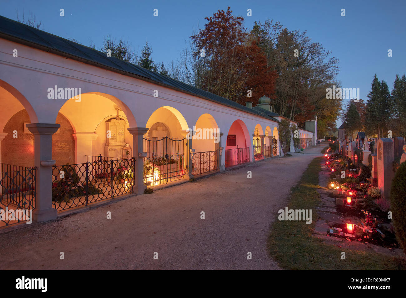 Cemetery in the village Teisendorf at All Saints Day with candles placed to honor deceased relatives. Upper Bavaria, Germany - Stock Image