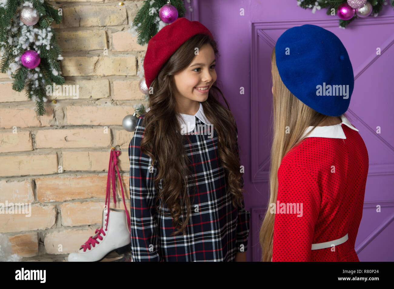Winter gossips concept. Lets have fun and celebrate christmas. Christmas tips for kids. Children cute girls ready meet christmas and new year. Girls small kids front festive christmas decorations. - Stock Image