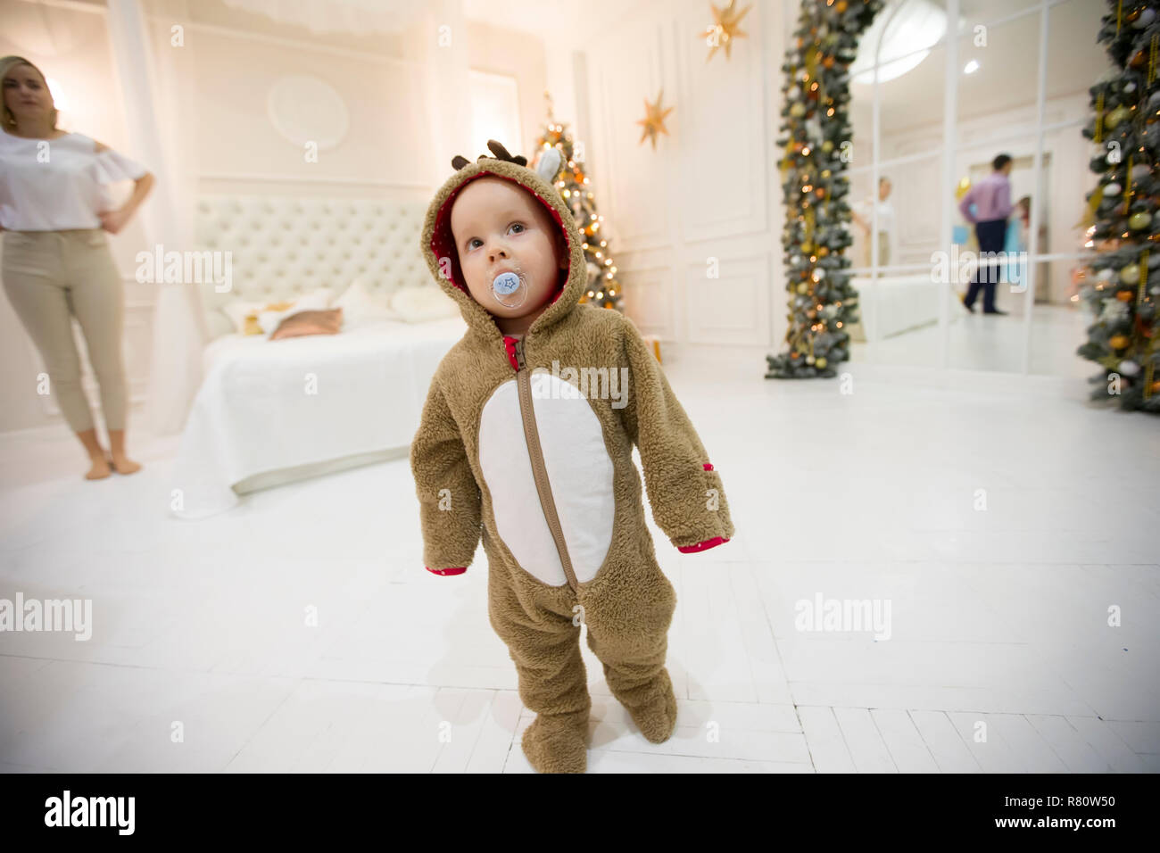 Kid in a carnival costume in the New Year's interior - Stock Image