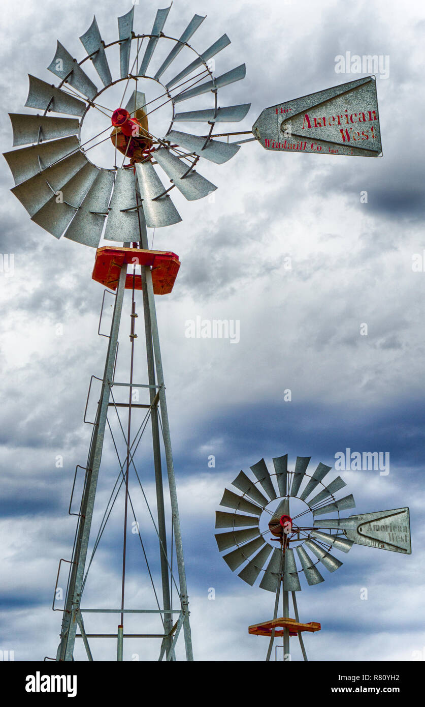 two wind wheels or wind pumps up close - Stock Image
