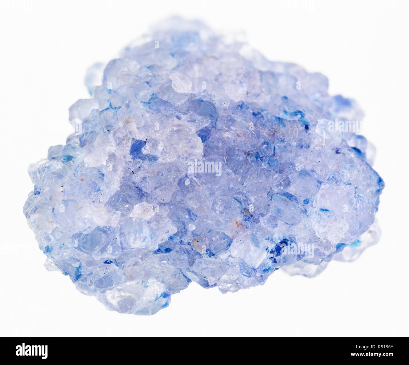 macro photography of natural mineral from geological collection - raw celestine (celestite) stone on white background - Stock Image