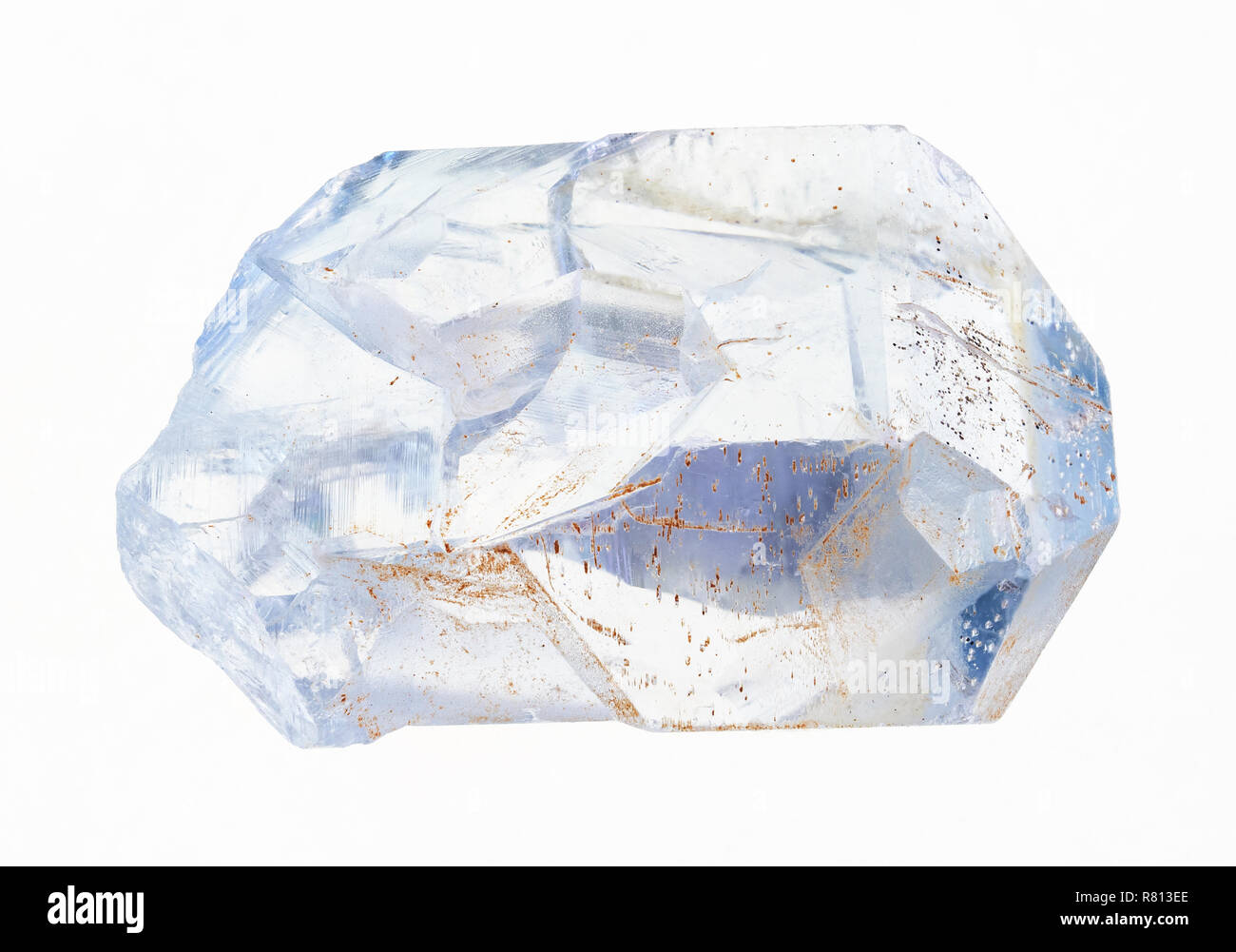 macro photography of natural mineral from geological collection - rough crystal of celestine (celestite) on white background - Stock Image